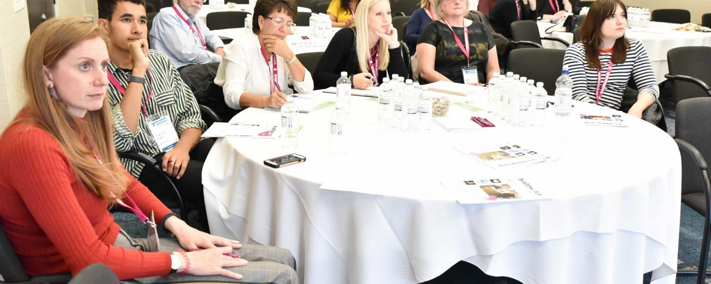 Participants sitting round a large table