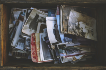 A wooden box, containing old photographs