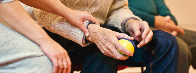 Woman holding an elderly man's hand